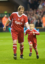 LIVERPOOL, ENGLAND - Thursday, May 14, 2009: Liverpool Legends' player/manager Kenny Dalglish and a mascot during the Hillsborough Memorial Charity Game at Anfield. (Photo by David Rawcliffe/Propaganda)