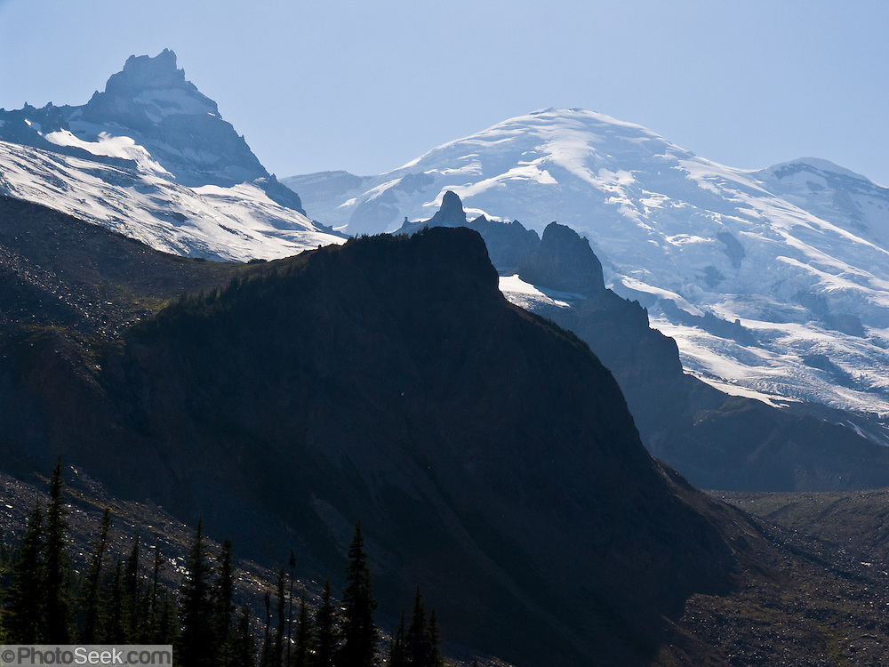 Mount Rainier rises to 14,411 feet elevation, seen from Panhandle Gap, on the Wonderland Trail, Mount Rainier National Park, Washington, USA.