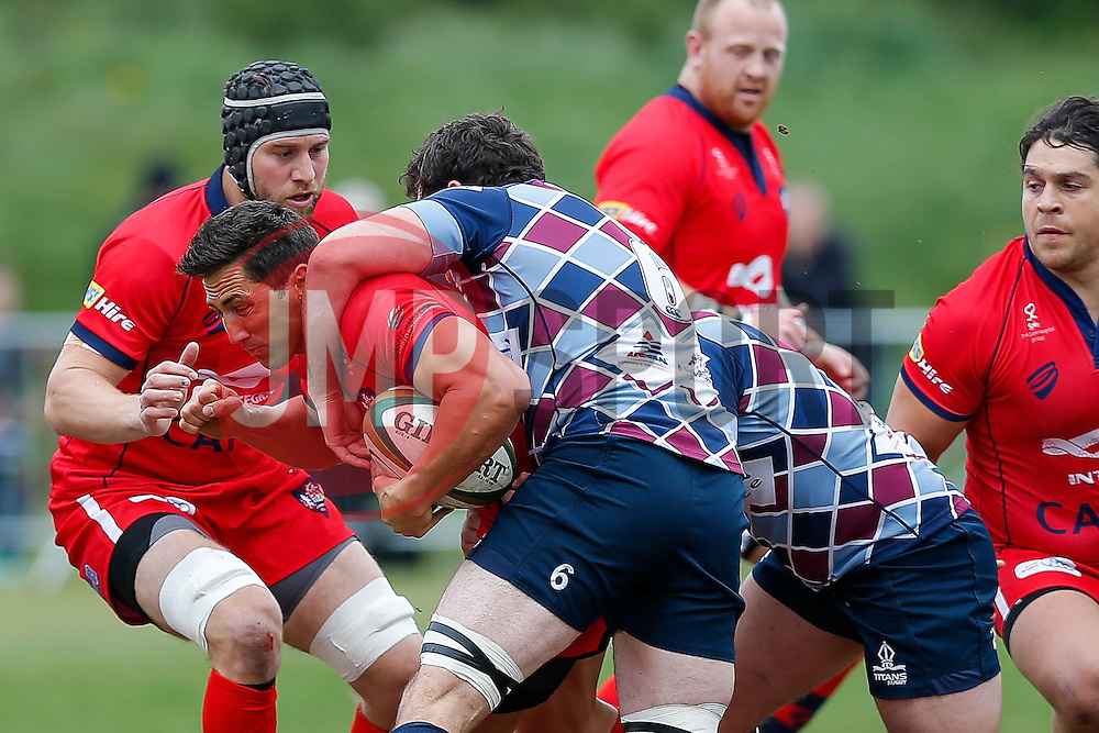 Bristol Rugby Inside Centre Gavin Henson is tackled by Rotherham Titans Flanker Alex Rieder and Inside Centre Jordan Davies - Photo mandatory by-line: Rogan Thomson/JMP - 07966 386802 - 10/05/2015 - SPORT - RUGBY UNION - Abbeydale Park, Sheffield - Rotherham Titans v Bristol Rugby - Greene King IPA Championship Play Off Semi Final Second Leg.