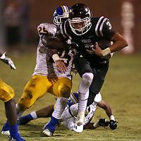 Lauren Wood | Buy at photos.djournal.com<br /> Kossuth's Beau Lee tries to escape Booneville's William Jackson as he makes a run during Friday night's game at Kossuth.