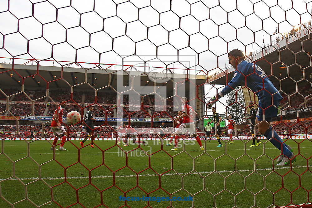 Graham Dorrans of Norwich scores his sides 2nd goal during the Sky Bet Championship match at the City Ground, Nottingham<br /> Picture by Paul Chesterton/Focus Images Ltd +44 7904 640267<br /> 17/09/2016