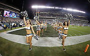 The Philadelphia Eagles cheerleaders wave pom poms as they jog off the field with the Thursday Night Football logo on the scoreboard in this general view photo of the Lincoln Financial Field stadium interior during the NFL week 3 football game against the Kansas City Chiefs on Thursday, Sept. 19, 2013 in Philadelphia. The Chiefs won the game 26-16. ©Paul Anthony Spinelli