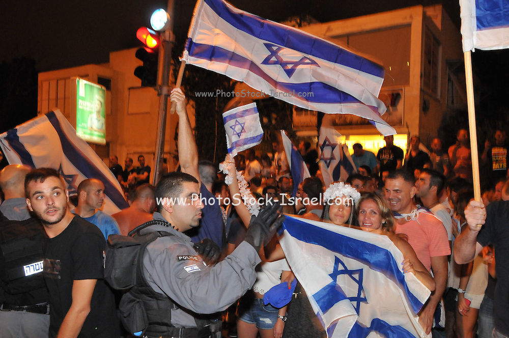 Pro Palestinian and Left wing activists demonstrated in Haifa, Israel on July 19th against the Israeli actions in Gaza. Opposite this group, a group of Right wing Israeli war supporters formed with a large police force separating the two opposing camps Photographed on July 19 2014