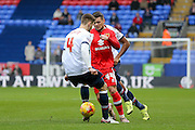 MK Dons midfielder, on loan from Brighton & Hove Albion, Jake Forster-Caskey  nutmegs Bolton Wanderers defender Dorian Dervite  during the Sky Bet Championship match between Bolton Wanderers and Milton Keynes Dons at the Macron Stadium, Bolton, England on 23 January 2016. Photo by Simon Davies.