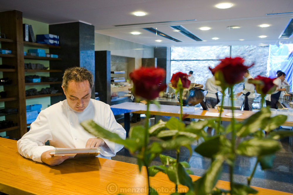 Ferran Adrià, a chef at the famous El Bulli restaurant near Rosas on the Costa Brava in Northern Spain, reviews menus in the kitchen area of the restaurant. (Ferran Adrià is featured in the book What I Eat: Around the World in 80 Diets.) MODEL RELEASED.