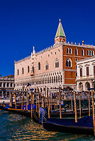 Gondolas along the waterfront with Doge's Palace behind, Venice, Italy.