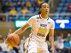 West Virginia Mountaineers guard Breana McDonald (20) looks to get past a defender against the Oklahoma Sooners during the first half at the WVU Coliseum.