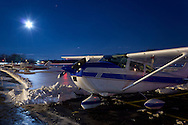 Montgomery, New York  - The full moon shines in the  sky over planes at Orange County Airport at twilight on Dec. 22, 2013.