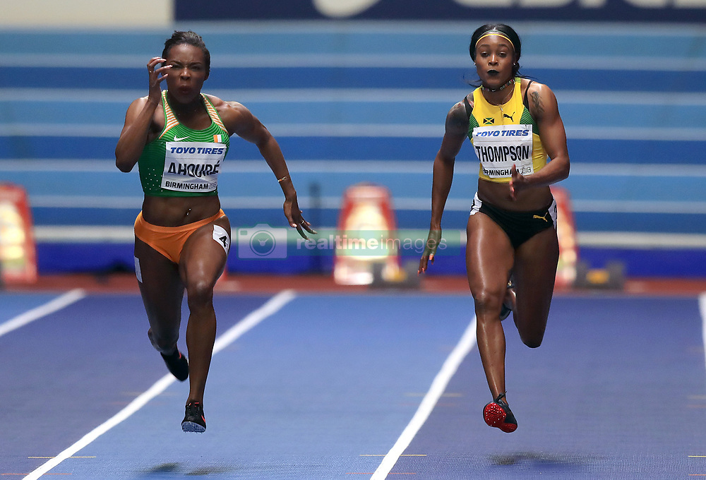 Ivory Coast's Murielle Ahoure (left) on her way to winning gold in the Women's 60m final ahead of Jamaica's Elaine Thompson (right) in fourth during day two of the 2018 IAAF Indoor World Championships at The Arena Birmingham.