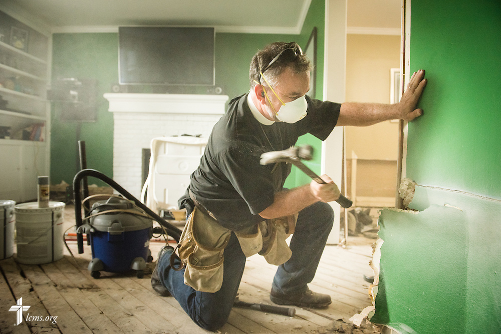 The Rev. Christopher Burger, pastor of Holy Trinity Lutheran Church in Columbia, S.C., assists a resident in a flood-damaged house on Friday, Oct. 9, 2015, in Columbia. LCMS Communications/Erik M. Lunsford