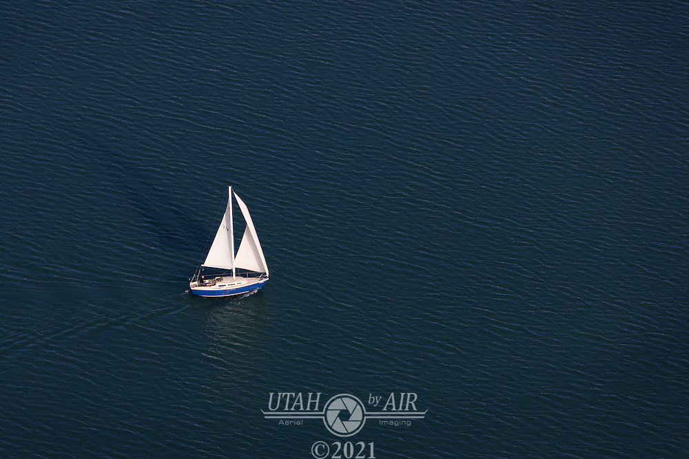 A lone sailboat on Utah Lake