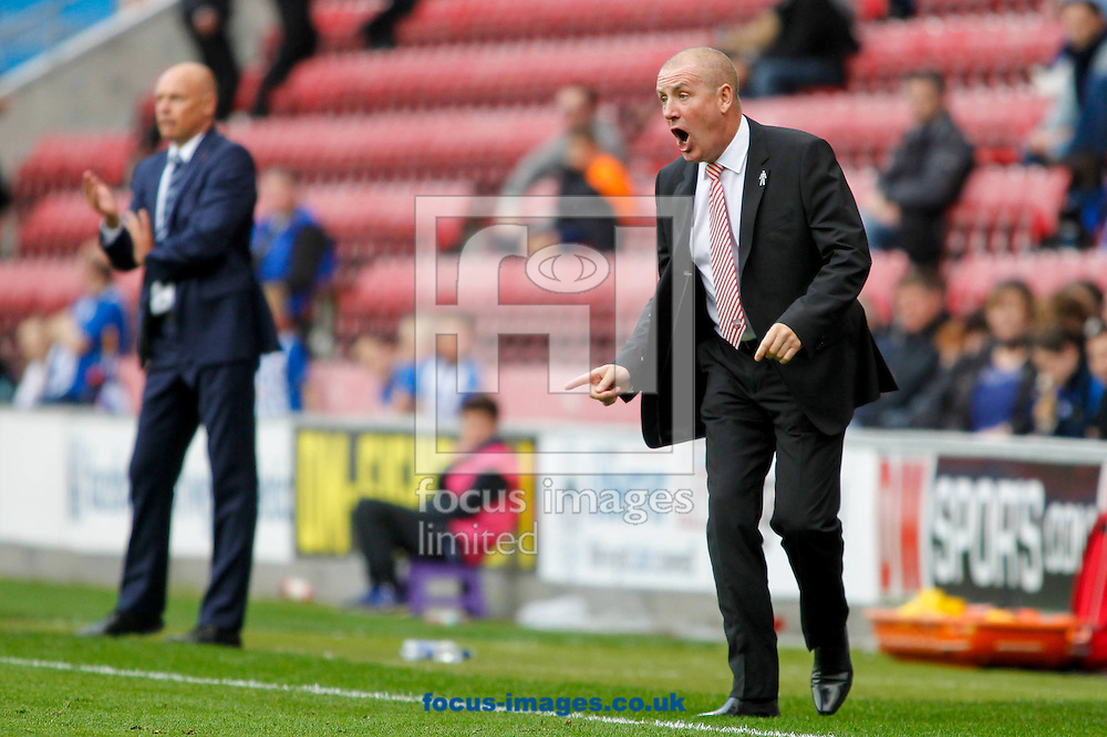 Brentford Manager Mark Warburton during the Sky Bet Championship match between Wigan Athletic and Brentford at the DW Stadium, Wigan<br /> Picture by Mark D Fuller/Focus Images Ltd +44 7774 216216<br /> 18/10/2014
