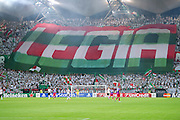 Legia's supporters during the UEFA Champions League play-off second leg match between Legia Warsaw and FC Steaua Bucuresti at Pepsi Arena Stadium in Warsaw on August 27, 2013.<br /> <br /> Poland, Warsaw, August 27, 2013<br /> <br /> Picture also available in RAW (NEF) or TIFF format on special request.<br /> <br /> For editorial use only. Any commercial or promotional use requires permission.<br /> <br /> Photo by &copy; Adam Nurkiewicz / Mediasport
