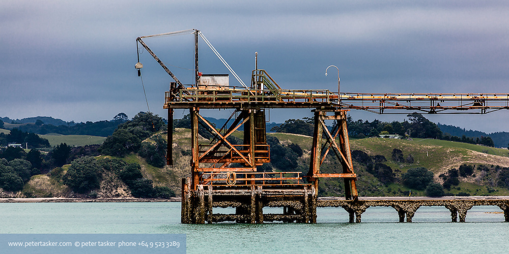 Karamuramu Island Quarry. Southern corner of the Hauraki Gulf. McCallum Bros Quarry loading rig.