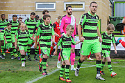 The teams enter the field of play during the Vanarama National League match between Forest Green Rovers and Barrow at the New Lawn, Forest Green, United Kingdom on 1 October 2016. Photo by Shane Healey.
