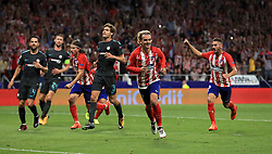 Atletico Madrid's Antoine Griezmann (centre) celebrates after scoring his side's first goal