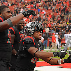 Oct 6, 2012: Rutgers Scarlet Knights linebacker Jamal Merrell (37) celebrates with the Scarlet Knight mascot's sword following their victory in NCAA college football action between the Rutgers Scarlet Knights and UConn Huskies at High Point Solutions Stadium in Piscataway, N.J.