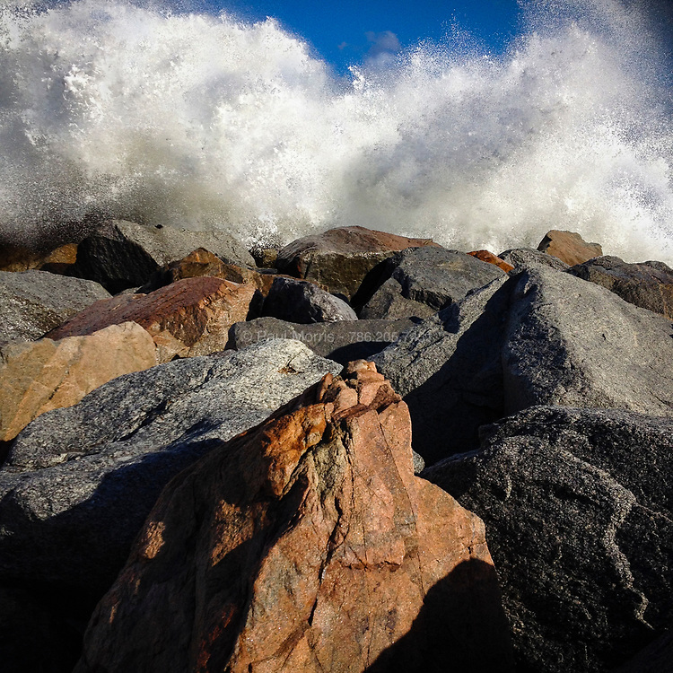 Stormy ocean waves crashing ont the rocks at Haulover Beach in Miami, Florida