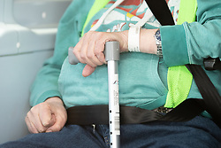 © Licensed to London News Pictures . 21/04/2020. Manchester, UK. Patient wrist ID tag pixelated at source . One of the first patients to be discharged from the hospital sits in an ambulance ahead of being taken home . The National Health Service has built a 648 bed field hospital for the treatment of Covid-19 patients , at the historical railway station terminus which now forms the main hall of the Manchester Central Convention Centre . The facility is treating patients from across the North West of England , providing them with general medical care and oxygen therapy after discharge from Intensive Care Units . Photo credit : Joel Goodman/LNP