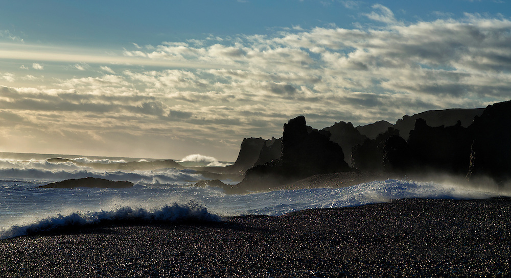 Peculiar rock formations and crashing waves on the black pebbled beach, Djúpalónssandur, Iceland