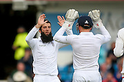 England & Worcestershire All-rounder Moeen Ali  gets the wicket of Sri Lanka wicket keeper Dinesh Chandimal  during day 3 of the first Investec Test Series 2016 match between England and Sri Lanka at Headingly Stadium, Leeds, United Kingdom on 21 May 2016. Photo by Simon Davies.