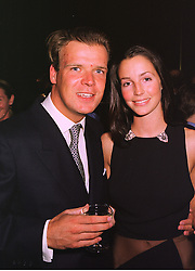 MR JOEL CADBURY and MISS SASHA COOKE, at an exhibition in London on 14th September 1998.MJZ 51
