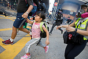 HONG KONG: Sunday 20 October 2019 A father with two young girls runs away from tear gas as violent clashes between pro-democracy demonstrators and riot police continued on Sunday throughout a number of districts in Hong Kong. Hundreds of thousands of protesters marched through the city's streets in defiance of the march being denied permission to take place as demonstrations roll into a 14th week. <br /> Rick Findler / Story Picture Agency