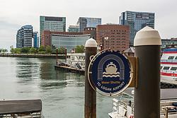 Water shuttle stop along the Boston Harborwalk at Rowes Wharf in Boston, Massachusetts.