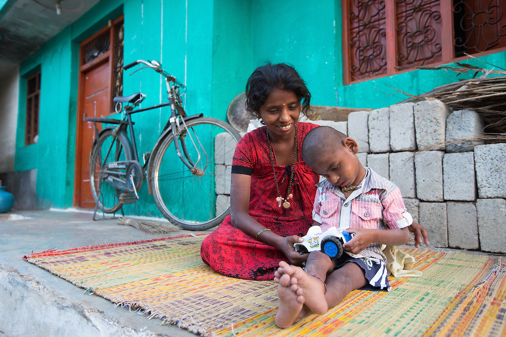 CAPTION: Mallesh has a severe learning disability. He needs almost constant care. During the earliest days following the birth of a child who has (or develops) a disability, parents often struggle to work out what best they can do for him or her, and could use more information and firmer direction. Under the Chamkol programme, such children aged between zero and five and their mothers, expectant mothers and women of child-bearing age will be able to get this through health, wellbeing, development and pre-school programmes run through Early Years' Clubs. LOCATION: Mahanthalpura (village), Kasaba (hobli), Chamrajnagar (district), Karnataka (state), India. INDIVIDUAL(S) PHOTOGRAPHED: Nandini M. (left) and Mallesh M. (right).