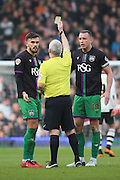 Bristol City midfielder, Marlon Pack (21) yellow card during the Sky Bet Championship match between Fulham and Bristol City at Craven Cottage, London, England on 12 March 2016. Photo by Matthew Redman.