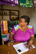 Asia Diwala doing some book keeping.<br /> <br /> Asia owns and runs a Batik business in KwaMatias, Tanzania.<br /> <br /> She attended MKUBWA enterprise training run by the Tanzania Gatsby Trust in partnership with The Cherie Blair Foundation for Women.