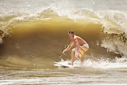 A surfer takes advantage of the tidal surge caused by approaching Hurricane Irene on August 25, 2011 in Folly Beach, South Carolina. Irene will bypass Charleston on the way to the outer banks of North Carolina.