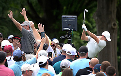 May 4, 2019 - Charlotte, NC, USA - Marshalls hold up their hands as golfer Rory McIlroy, right, goes into his backswing at the 6th tee box at Quail Hollow Club in Charlotte, N.C., during third-round action of the Wells Fargo Championship on Saturday, May 4, 2019. (Credit Image: © TNS via ZUMA Wire)