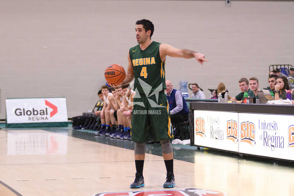4th year guard Alex Igual (4) of the Regina Cougars in action during the home game on November  5 at Centre for Kinesiology, Health and Sport. Credit: /Arthur Images