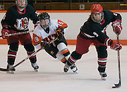 2012/03/04 - Plattsburgh Allison Era is pursued by RIT's Marissa Maugeri during the first period of the ECAC West Championship game between RIT and SUNY Plattsburgh at RIT's Ritter Arena on March 4th, 2012. RIT lead 1-0 after one period of play.