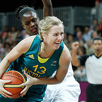30 July 2012: Rachel Jarry of Australia drives past Emilie Gomis of France during the 74-70 Team France overtime victory over Team Australia, during the women's basketball preliminary, at the Basketball Arena, in London, Great Britain.