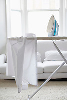 White shirt on ironing board in living room