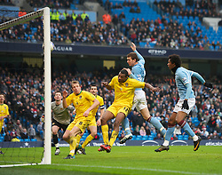 MANCHESTER, ENGLAND - Sunday, February 20, 2011: Manchester City's Edin Dzeko scores the fourth goal against Notts County during the FA Cup 4th Round Replay match at the City of Manchester Stadium. (Photo by David Rawcliffe/Propaganda)