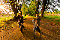 Women bicycling, Gross Schwansee, Germany
