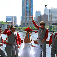 Bride shocked as the bouquet explodes during the groomsmen jumping. The details make the wedding. Make sure that every detail of your special day is documented through images. After months/years of planning all you have left at the end of the day is your memories and hopefully numerous professional images.