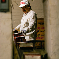 Employee packing boxes of matzoh for shipping at Streit's Matzoh factory, NYC.