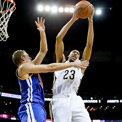 Nov 26, 2013; New Orleans, LA, USA; New Orleans Pelicans power forward Anthony Davis (23) rebounds over Golden State Warriors power forward David Lee (10) during the second half of a game at New Orleans Arena. The Warriors defeated the Pelicans 102-101. Mandatory Credit: Derick E. Hingle-USA TODAY Sports