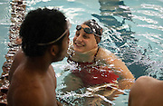 """Always smiling. Always positive,"" Lehi High School swimming coach Dennis Meyring said of his athlete Amy Chapman. Chapman, 17, is seen here doing just that during practice at the Lehi Legacy Center, Tuesday, Dec. 18, 2012."