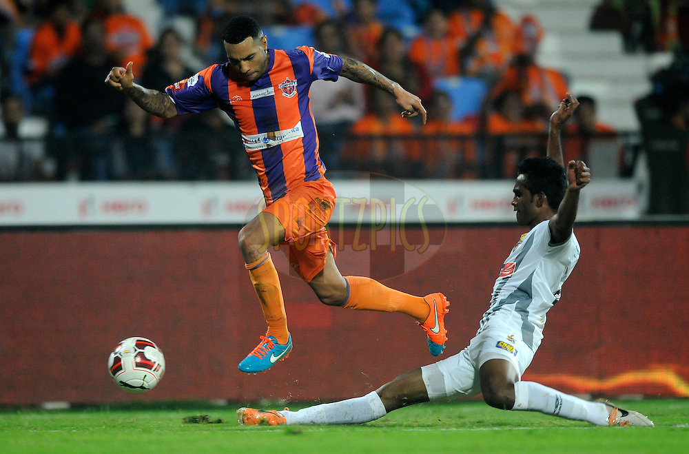 Jermaine Pennant of FC Pune City and Nallappan Mohanraj of Atletico de Kolkata in action during match 44 of the Hero Indian Super League between FC Pune City and Atletico de Kolkata FC held at the Shree Shiv Chhatrapati Sports Complex Stadium, Pune, India on the 29th November 2014.<br /> <br /> Photo by:  Pal Pillai/ ISL/ SPORTZPICS