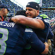 Seattle Seahawks player Jermaine Kearse hugs quarterback Russell Wilson after Wilson threw Kearse the game-winning touchdown in overtime against the Green Bay Packers during the NFC Championship game. The Seahawks won 28-22 and earned a second trip to the Super Bowl. Photographed on Sunday, January 18, 2015. (Joshua Trujillo, seattlepi.com)