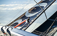 Pictures of Alex Thomson the skipper of the Hugo Boss IMOCA Open 60 race yacht walking up the mast of his yacht whilst sailing.<br /> Credit - Lloyd Images/Alex Thomson Racing