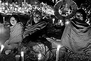 """Day of the Dead, Janitzio island, the cemetery. The celebrations are held from sunset until sunrise, with candles, food and drinks for the souls. The Dia de Muertos (Day of the Dead), recently declared by UNESCO as an """"oral and intangible cultural heritage of humanity,"""" is one of Mexico's most cherished traditions, celebrated in cities and villages countrywide, but perhaps nowhere moreso than in the state of Michoacan. During prehispanic times, Patzcuaro's lake was thought to be an important entrance to the """"Inframundo"""" – the Indian Underworld. During Dia de Muertos, the Inframundo's doors open, and the souls of the departed return to earth to visit their earth-bound family and friends. At night in the small graveyard on Janitzio Island, illuminated only by a sea of candles, Purepecha women speak quietly with beloved departed souls at graves adorned with offerings of food, candies, liquor, cigarettes, evertything their dead  enjoyed while alive."""
