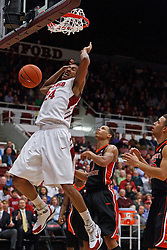 Feb 16, 2012; Stanford CA, USA; Stanford Cardinal forward Josh Huestis (24) dunks past Oregon State Beavers guard Jared Cunningham (1) during the first half at Maples Pavilion.  Mandatory Credit: Jason O. Watson-US PRESSWIRE
