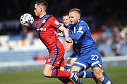 Ian Henderson is challenged by Ryan McLaughlin during the EFL Sky Bet League 1 match between Oldham Athletic and Rochdale at Boundary Park, Oldham, England on 22 April 2017. Photo by Daniel Youngs.
