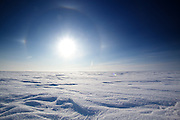 &quot;Winter kept us warm, covering<br /> Earth in forgetful snow....&quot;  - T.S. Eliot<br /> <br /> A sun dog warms the spirits of those below, as the endless expanse of a very frozen Great Slave Lake goes on and on in the far Canadian north.<br /> <br /> www.facebook.com/davebroshaphotography ( http://www.facebook.com/davebroshaphotography ) <br /> <br />  View bigger ( http://farm5.static.flickr.com/4070/4378021860_0c8c2626e4_b.jpg )